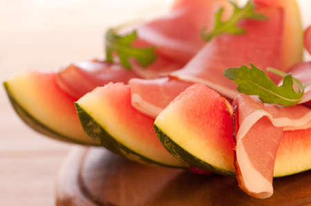Close up of fresh water melon with parma ham and rocket salad photo