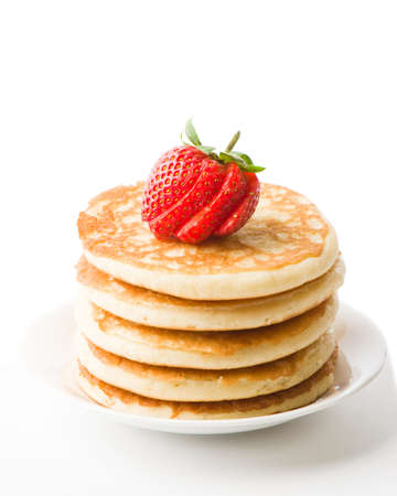 freshly prepared: Stack of freshly prepared pancakes topped with strawberry Stock Photo