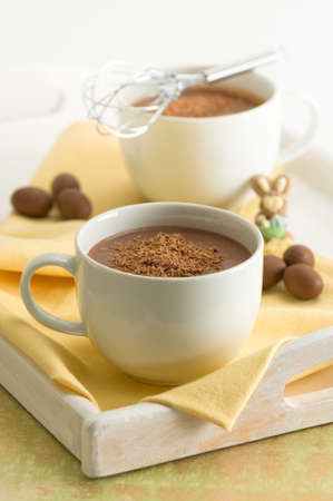 chocolate sprinkles: Hot chocolate drinks with mini Easter eggs and cheeky bunny rabbit Stock Photo