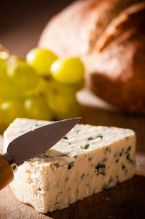 stilton: Blue stilton cheese with grapes and rustic loaf of bread
