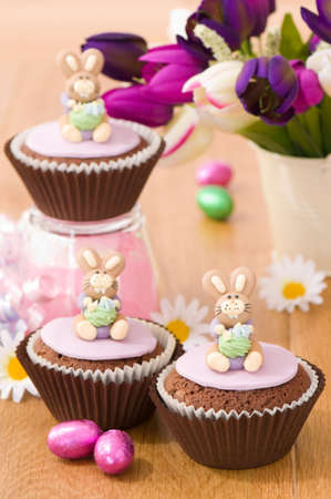 Springtime bunny rabbit cupcakes for Easter break with foil wrapped eggs photo