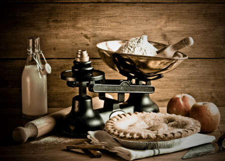 ingredient: Old fashioned apple pie dessert with antique weighing scales