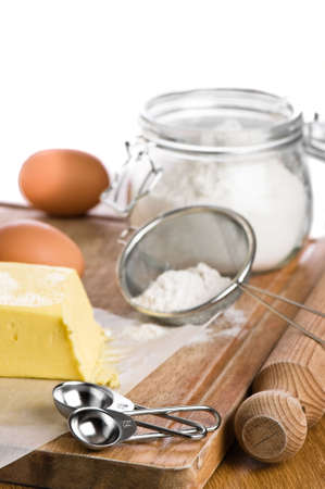 sifter: Baking ingredients with rolling pin and measuring spoons Stock Photo