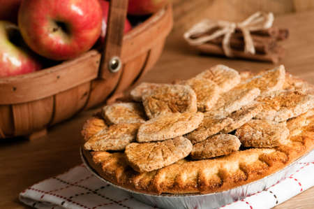 freshly: Freshly baked farmhouse apple pie with trug filled with fruit in background