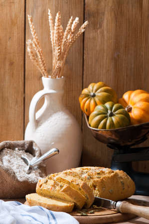 Sliced pumpkin bread in rustic farmhouse setting photo