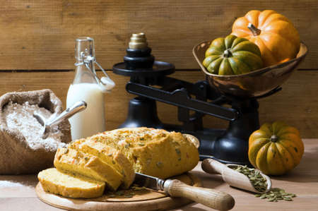 Sliced pumpkin bread in rustic farmhouse setting with old fashioned weighing scales  photo