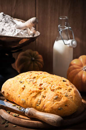 Freshly baked loaf of pumpkin bread in farmhouse setting photo