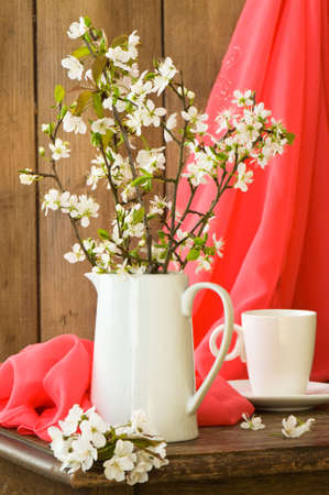 Still life setting with apple blossom in rustic setting photo
