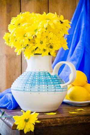 material flower: Still life of Chrysanthemum flowers in a vase in rustic setting