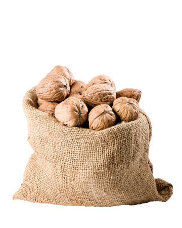 Burlap sack full of whole walnuts isolated on white background Stock Photo - 6900230