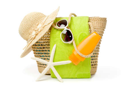 beach animals: Beach bag with items for a day at the seaside on white background