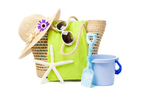 Beach items including bucket and spade on white background photo