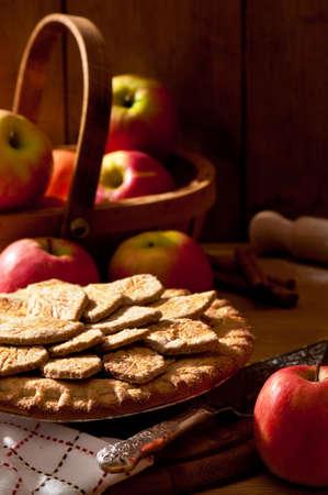 Rustic autumn apple pie in farmhouse setting  photo