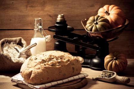loaf: Freshly baked pumpkin seed bread in farmhouse setting