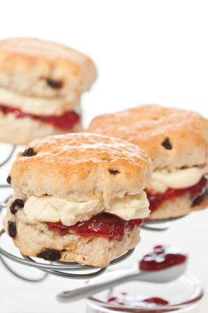 devon: Strawberry and cream scones on white background Stock Photo