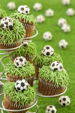 cake ball: Close up of cupcakes with footballs