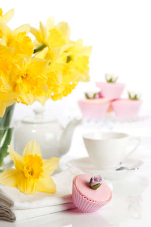 Afternoon tea party with rose cupcakes and spring flowers Stock Photo - 7236095