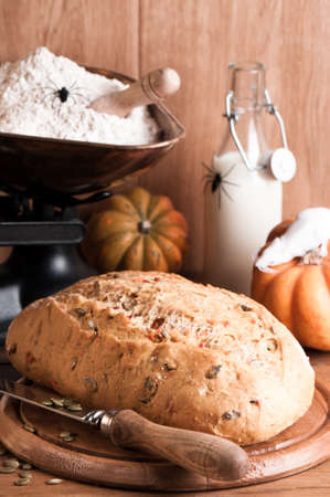 Pumpkin bread for halloween with spiders in rustic setting Stock Photo - 7257405