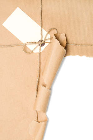 pack string: Opened parcel tied with string with blank label, copy space included within torn section