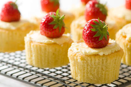 cakes: Pretty strawberry topped cupcakes on wire rack