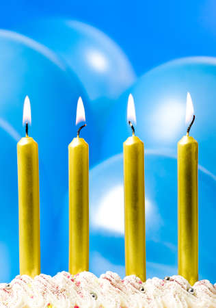 Gold party candles with blue balloon background photo