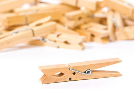 Wooden clothes pegs on white background photo