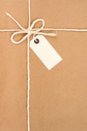 Parcel tied with string with address label attached Stock Photo - 7438896