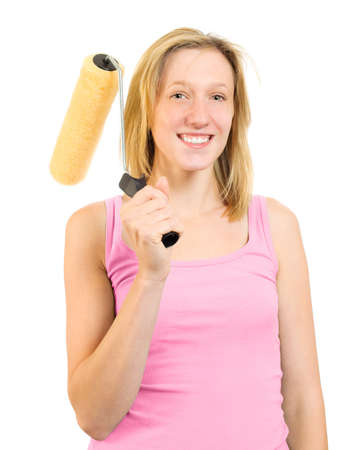Happy smiling woman holding decorating roller brush on white background photo