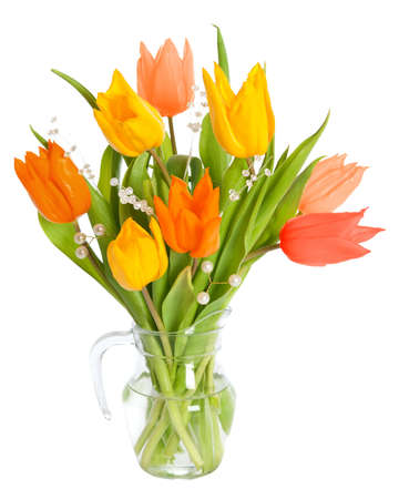 Colourful tulip flowers in glass vase isolated on white background Stock Photo