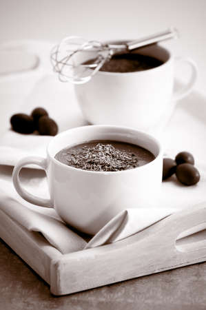 hot chocolate drink: Hot chocolate drinks on tray with toned effect