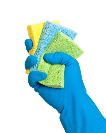 scrubbing up: Washing up sponges  in gloved hand on white background