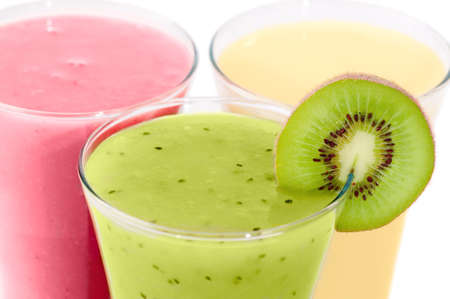Close up of three breakfast smoothies on white background