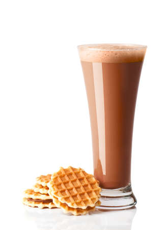 Chocolate smoothie drink in tall glass with wafer biscuits on white background
