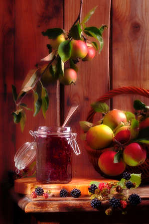 Blackberry and apple jam in rustic country cottage setting photo
