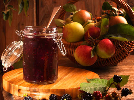 Blackberry & apple preserve in rustic country cottage setting photo