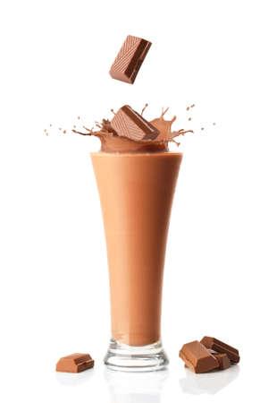 Chocolate smoothie milkshake with chocolate chunks splashing into it