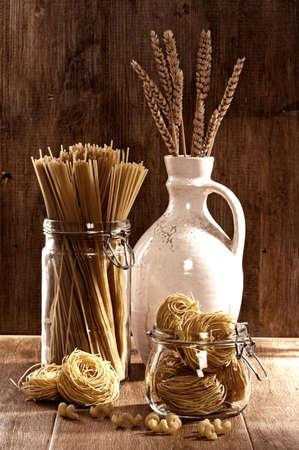 Vintage style image of dried pasta with spaghetti, spirali & vermicelli Standard-Bild