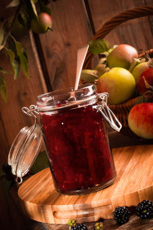 orchard: Homemade blackberry and apple jam with autumn fruits