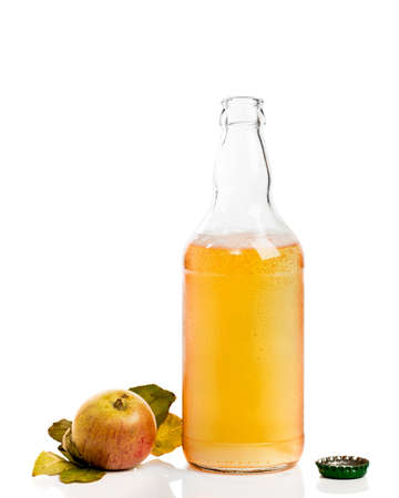 Opened bottle of cider with apples on white background
