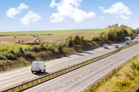 the carriageway: Motorway image taken with tilt-shift lens to give miniature effect Stock Photo