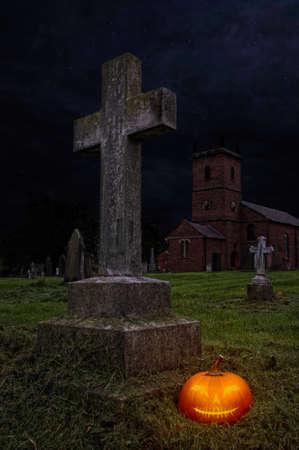 churchyard: Halloween pumpkin lantern in churchyard at night Stock Photo