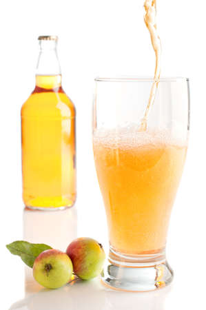 Pouring a glass of scrumpy cyder on white background photo