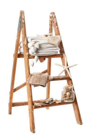 Wash day stepladder with towels and clothes pegs on white background photo