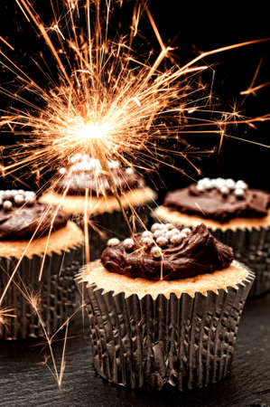 chocolate cupcakes: Cupcakes decorated with chocolate ganache with sparklers