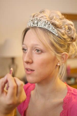 Bride getting her make up done before her wedding - shallow depth of field and focus on brides eye photo