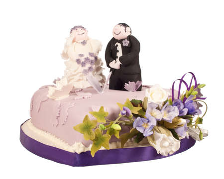 Top tier of wedding cake with bride and groom made from sugar icing photo