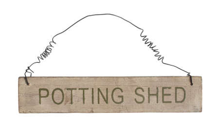 sheds: Potting shed wooden hanging sign on white background Stock Photo