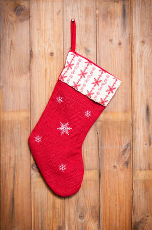 stockings: Christmas stocking hanging on grungy wooden background