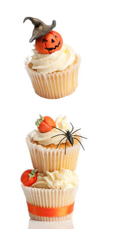 Halloween cupcakes decorated with pumpkins, top one floating  photo