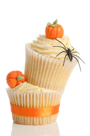 halloween spider: Homemade Halloween pumpkin cupcakes on white background for trick or treat night